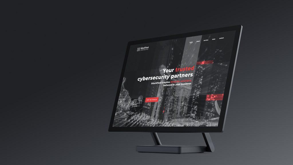 desktop monitor displaying homepage design