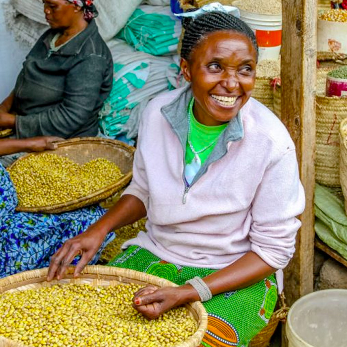 woman working with yellow seeds