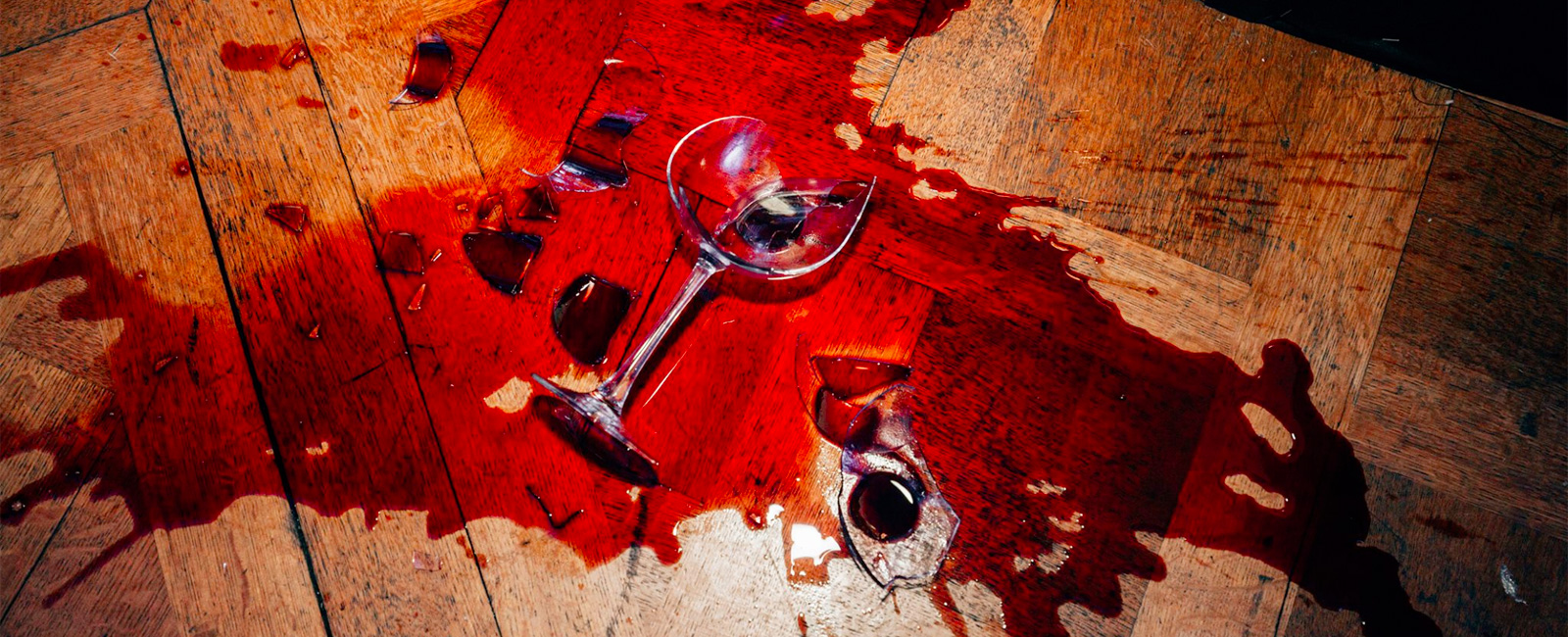 spilled red wine on floor with broke glass