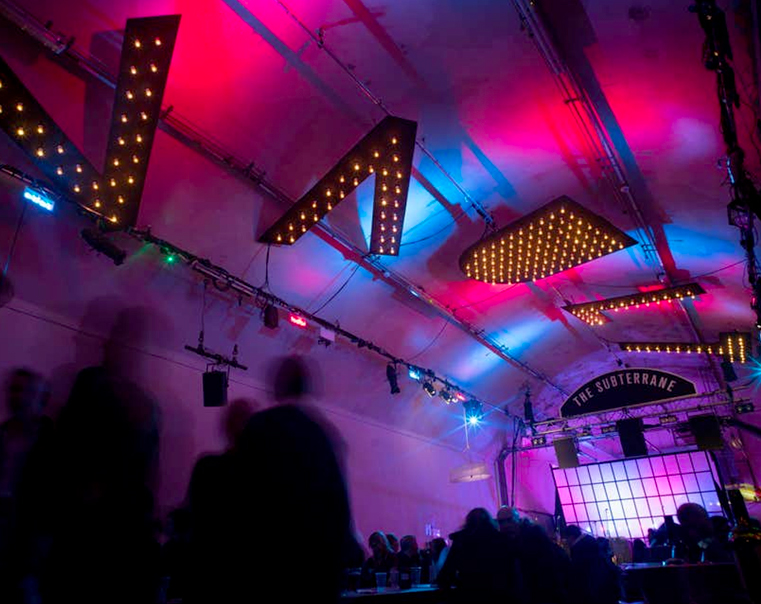 indoor festival with branding on ceiling
