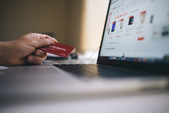 ecommerce transation with credit card and laptop