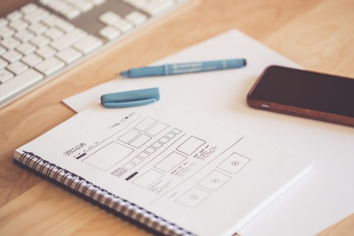 notepad displaying website design architecture