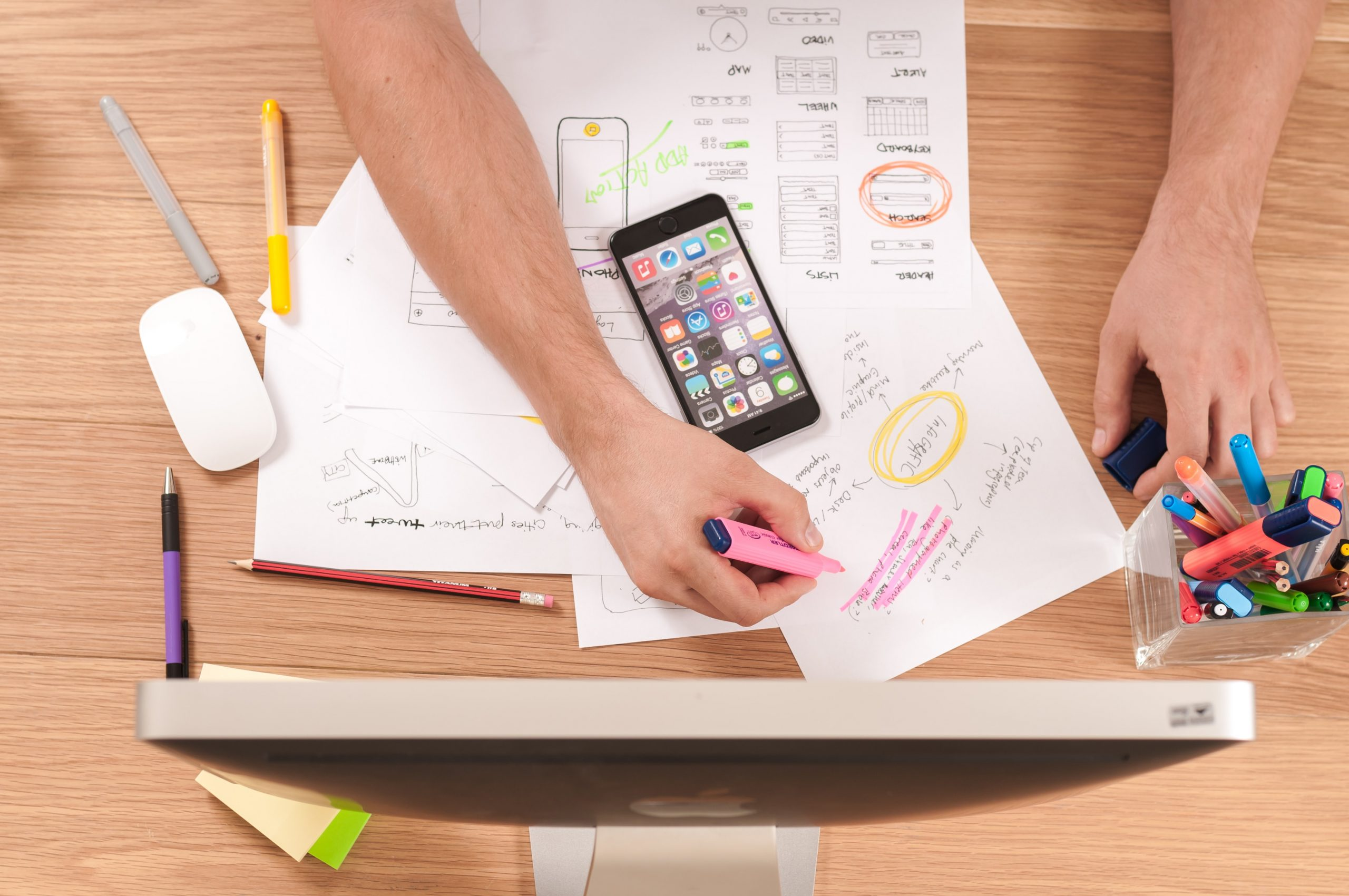 monitor and smartphone with website planning documents